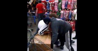Men squabble over a toy during Black Friday. (Screenshot via Youtube/Newsstar 2018)