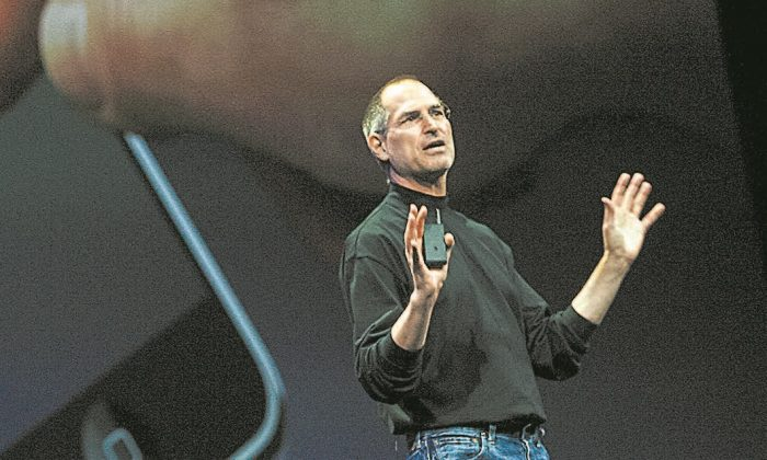 Apple CEO Steve Jobs unveils the first iPhone at the Macworld developers conference in San Francisco on Jan. 9, 2007. Since then, Apple and other innovative companies have developed hundreds of different models, constantly improving the user experience.  (TONY AVELAR/AFP/GETTY IMAGES)