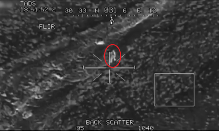 An alleged Taliban fighter moments before being hit by a missile launched by an AH-64 Apache helicopter. (U.S. Army)