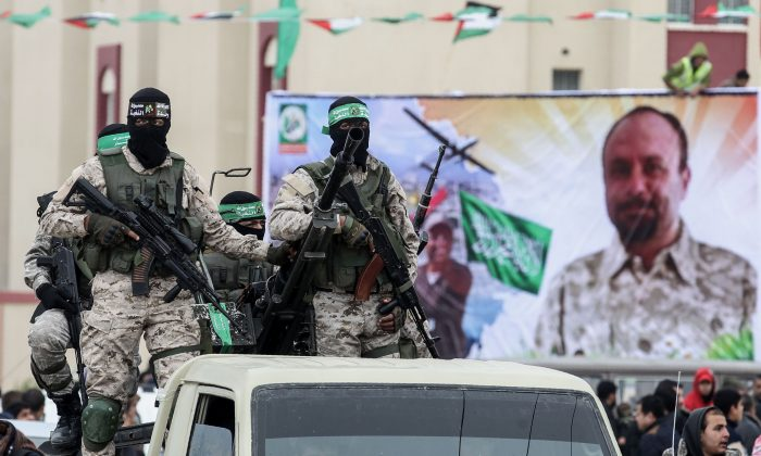 Members of the Izzedine al-Qassam Brigades, the military wing of the Palestinian Islamic terrorist group Hamas, attend a memorial in the Gaza Strip on Jan. 31, 2017. (Said Khatib/AFP/Getty Images)