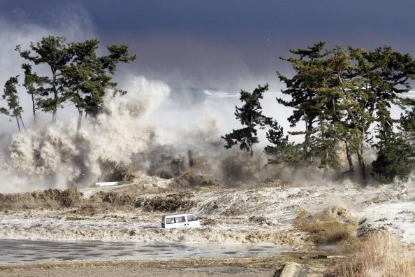 Tsunami waves hitting the coast of Minamisoma in Fukushima prefecture, Japan, March 11 2011. (Sadatsugu Tomizawa/AFP/Getty Images)