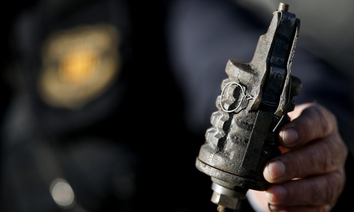 Man accidentally kills himself after taking the pin out of a grenade and then posing to take a photo with it (Stock photo / AU BARRENA/AFP/Getty Images)