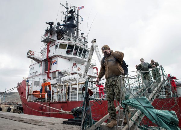 Members of the U.S. Navy Undersea Rescue Command (URC) disembark from the Sophie Siem vessel moored at Comodoro Rivadavia harbour after installing their deep diving rescue vehicle - the Pressurized Rescue Module (PRM) of the Submarine Rescue Diving and Recompression System (SRDRS) - to support the search and rescue efforts for the Argentine missing submarine ARA San Juan in Comodoro Rivadavia, Chubut province, Argentina on November 26, 2017.<br /> Weather conditions for the search were good on November 25 -- better than the difficult stormy weather of the past week -- but likely to deteriorate on 26. An army of welders worked frantically to create an opening in the stern of the Norwegian offshore supply ship Sophie Siem, owned by oil company Total, large enough to accommodate an underwater rescue capsule sent by the US Navy. The US capsule can rescue up to 16 trapped submarine sailors at a time in shifts of 20 minutes, experts said. / AFP PHOTO / PABLO VILLAGRA (Photo credit should read PABLO VILLAGRA/AFP/Getty Images)