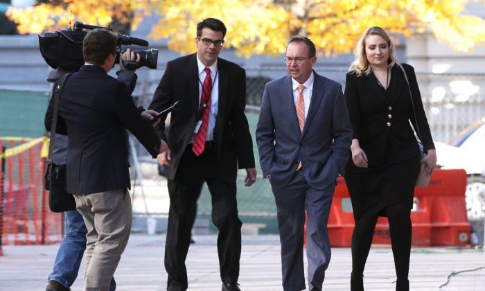 Director of the Office of Management and Budget Mick Mulvaney (C), President Donald Trump's pick for acting director of the Consumer Financial Protection Bureau, walks to the White House from the CFPB building on his first day of work in Washington on Nov. 27, 2017. (Alex Wong/Getty Images)