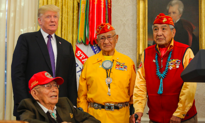 (L-R) President Donald Trump hosts Fleming Begaye, Thomas Begay, and Peter MacDonald, Navajo Code Talkers from World War II, in the Oval Office at the White House on Nov. 27. (Oliver Contreras-Pool/Getty Images)