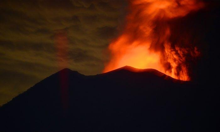 Mount Agung's ongoing eruption seen at night from Kubu sub-district in Karangasem Regency on Indonesia's resort island of Bali on Nov. 28, 2017. (Sonny Tumbelaka/AFP/Getty Images)