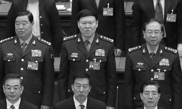 Zhang Yang (center), former member of the Central Military Commission, with other Chinese Communist Party officials at a meeting of the 12th National People's Congress at the Great Hall of the People in Beijing, China, on March 15, 2017. (Photo by Lintao Zhang/Getty Images)