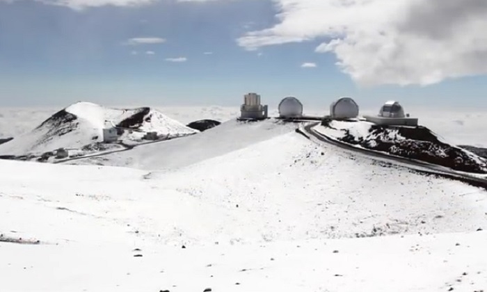 A mid-2011 file image of snow covered Mauna Kea in Hawaii which again is currently covered by snow. (YouTube screenshot via Hawaii247.com)