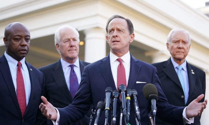 Senate Finance Committee members (L–R) Sen. Tim Scott (R-SC), Sen. John Cornyn (R-TX), Sen. Pat Toomey (R-PA) and Chairman Orrin Hatch (R-UT) talk with reporters following a lunch meeting with President Donald Trump at the White House, in Washington on Nov. 27, 2017 . (Chip Somodevilla/Getty Images)
