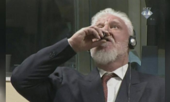 A wartime commander of Bosnian Croat forces, Slobodan Praljak, is seen during a hearing at the U.N. war crimes tribunal in the Hague, Netherlands, November 29, 2017. (ICTY via REUTERS TV)