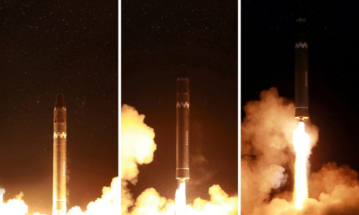 North Korea said the new missile reached an altitude of about 4,475 km (2,780 miles) - more than 10 times the height of the International Space Station - and flew 950 km (590 miles) during its 53-minute flight. (Reuters/KCNA)