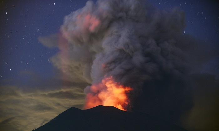 Mt. Agung erupting at night from Kubu sub-district in Karangasem Regency on Indonesia's resort island of Bali on Nov. 28, 2017. (Sonny Tumbelaka/AFP/Getty Images)