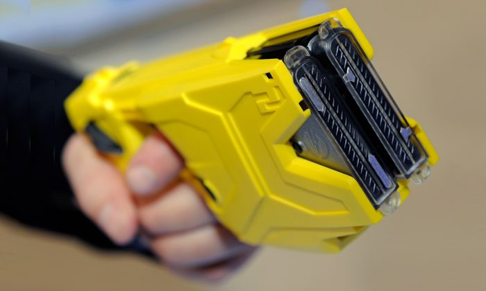 A two-shot Taser can strike multiple targets, as these officers learned the hard way. (Ethan Miller/Getty Images)
