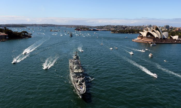 Royal Australian Navy warship HMAS Paramatta sails in front of the iconic Sydney Opera House on Oct. 4, 2013. (SAEED KHAN/AFP/Getty Images)