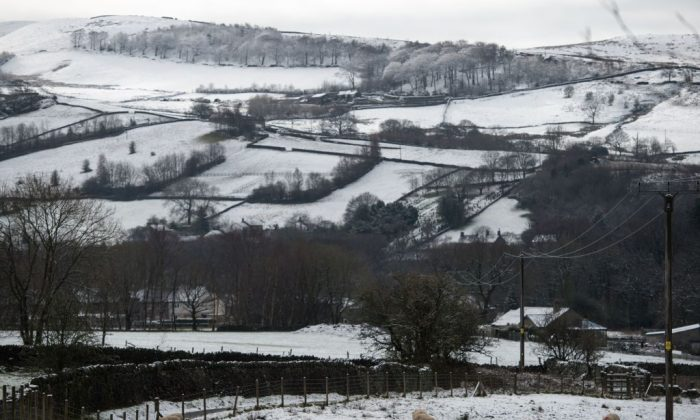 Snow covers the hills and fields surrounding the village of Hayfield in northern England, on February 28, 2017. Snowfall at the end of 2017 would also look very much like this.  (Oli Scarff/AFP/Getty Images)