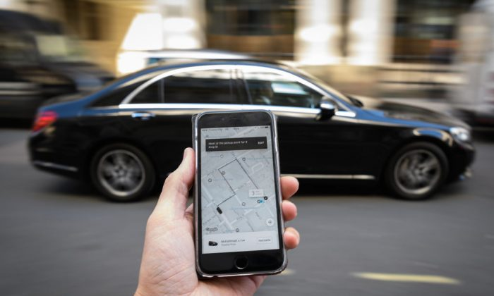 In this Photo Illustration, a phone displays the Uber ride-hailing app on September 22, 2017 in London, England. (Leon Neal/Getty Images)