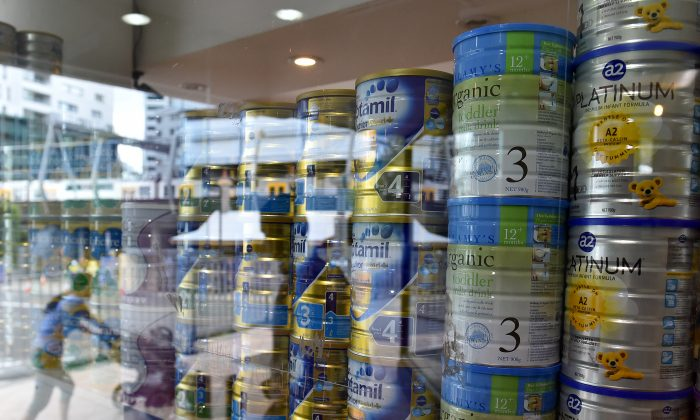A shop window displaying tins of baby milk formula in Sydney on Feb. 16, 2016. (Saeed Khan/AFP/Getty Images)