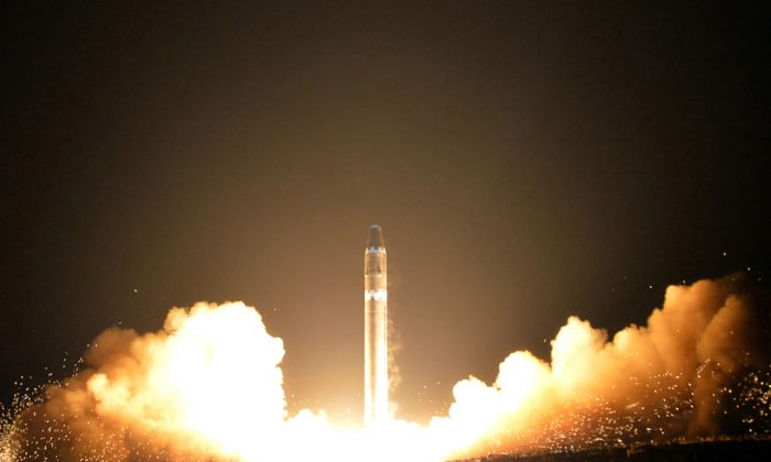 Photo released on Nov. 30 by North Korea's official Korean Central News Agency (KCNA) shows launching of the Hwasong-15 missile, which is capable of reaching all parts of the United States.  (KCNA VIA KNS/AFP/Getty Images)