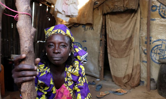 Zainab Bukar, an internally displaced person living in Bama camp, Nigeria, poses for a picture in her shelter November 23, 2017.  Picture taken November 23, 2017.  (Reuters/Paul Carsten)