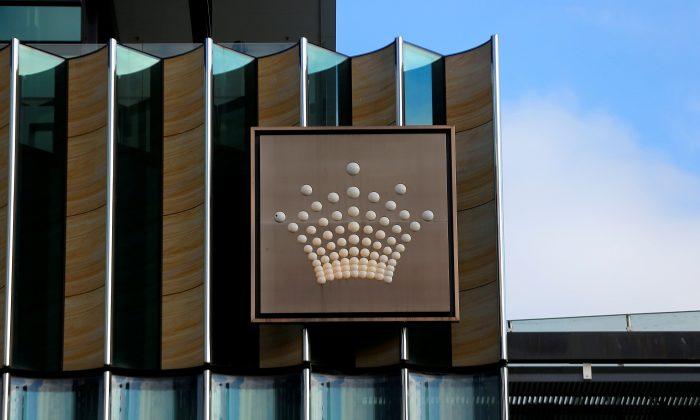 The logo of Australian casino giant Crown Resorts Ltd adorns the hotel and casino complex in Melbourne, Australia, June 13, 2017.       (Reuters/Jason Reed/File Photo)