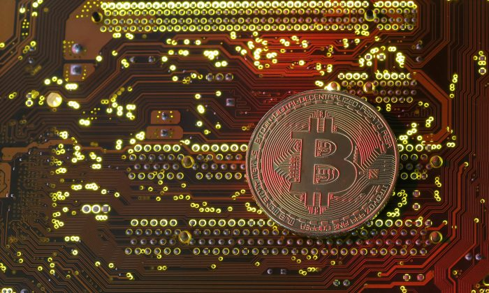 A copy of bitcoin standing on PC motherboard is seen in this illustration picture, Oct. 26, 2017. (Reuters/Dado Ruvic/File Photo)