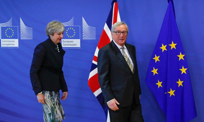 Britain's Prime Minister Theresa May is welcomed by European Commission President Jean-Claude Juncker at the EC headquarters in Brussels, Belgium Dec. 4, 2017. (Reuters/Yves Herman)