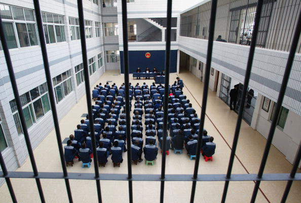 Prisoners attend a commutation sentence at the Hongshan Prison in Hubei Province on Dec. 10, 2004. (China Photos/GettyImages)
