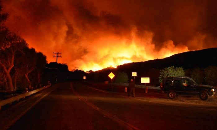 """Firefighters are battling a fast-moving brush fire, officially named the """"Thomas Fire"""", that has burned at least 500 acres and is threatening homes. (Ventura County Fire Department)"""