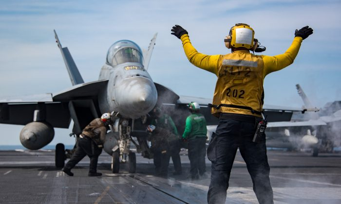 "U.S. Navy sailors conduct flight operations Tuesday, May 2, 2017 aboard the Nimitz-class aircraft carrier USS Carl Vinson (CVN 70) in the western Pacific Ocean. U.S. Navy's top leadership said on Monday that the size of the United States Navy is now at its ""smallest in a century,"" while still facing ever-rising threats. (Sean M. Castellano/US Navy via Getty Images)"