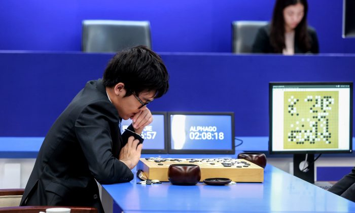 China's 19-year-old Go player Ke Jie prepares to make a move against Google's artificial intelligence program AlphaGo, in Wuzhen, eastern China's Zhejiang Province on May 25, 2017.  (STR/AFP/Getty Images)