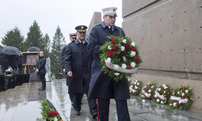 Halifax firefighters lay a wreath at a ceremony to mark the 100th anniversary of the Halifax Explosion at Fort Needham Memorial Park in Halifax on Dec. 6, 2017. Two ships, the SS Imo and the SS Mont Blanc, collided in the harbour and the resulting explosion remains the worst human-made disaster in Canadian history. (The Canadian Press/Andrew Vaughan)