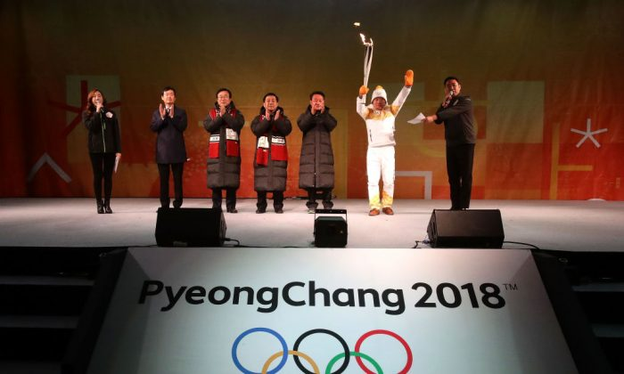 Torch bearer Yang Jung-Mo holds the Pyeongchang 2018 Winter Olympics torch during the PyeongChang 2018 Winter Olympic Games torch relay on Nov. 4, 2017, in Busan, South Korea.  (Chung Sung-Jun/Getty Images)