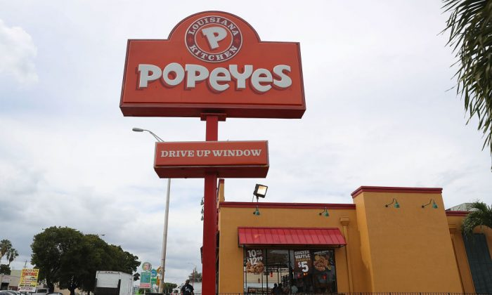 Father kills gunman who threatened his children during Popeyes robbery