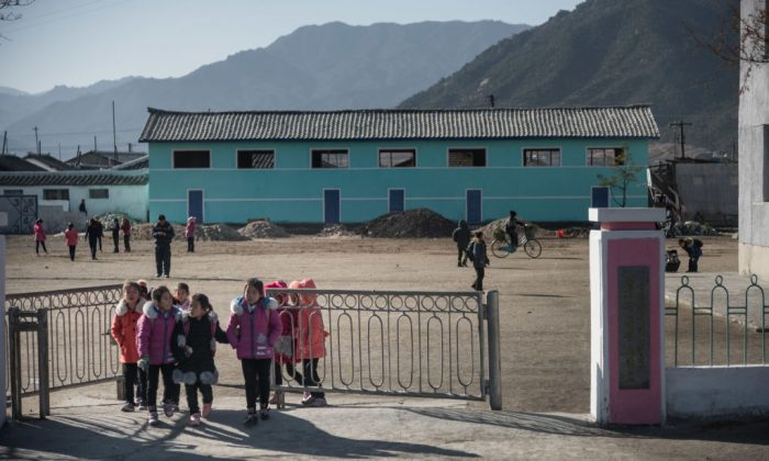 Children walk through a gate in a township north of Wonsan, North Korea, on Nov. 18, 2017. (Ed Jones/AFP/Getty Images)