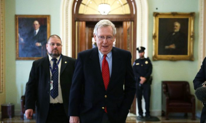 Senate Majority Leader Mitch McConnell (R-Ky.) walks from the Senate chamber to his office on Dec. 1. The Senate voted in favor of a Republican tax bill on Dec. 2. (ALEX WONG/GETTY IMAGES)