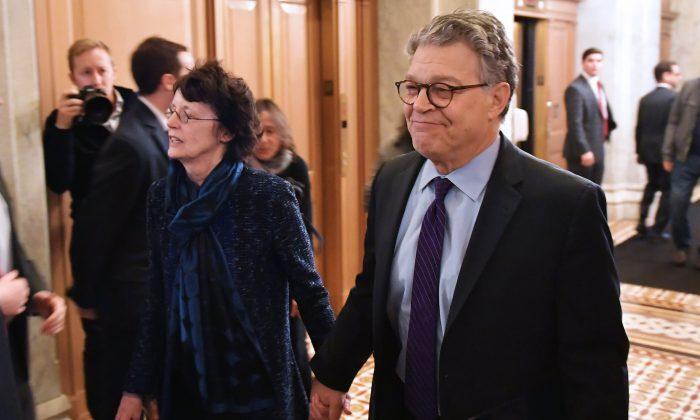 Senator Al Franken (D-Minn) and his wife Franni Bryson arrive at the U.S. Capitol on Dec. 7, 2017. (MANDEL NGAN/AFP/Getty Images)