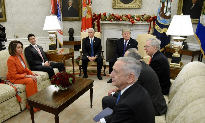 President Donald Trump and Vice President Mike Pence meet with Congressional leadership including House Minority Leader Rep. Nancy Pelosi (D-CA), House Speaker Paul Ryan (R-WI), Senate Majority Leader Mitch McConnell, Sen. Chuck Schumer (D-NY) and U.S. Defense Secretary James Mattis in the Oval Office of the White House on December 7, 2017. (Olivier Douliery - Pool/Getty Images)