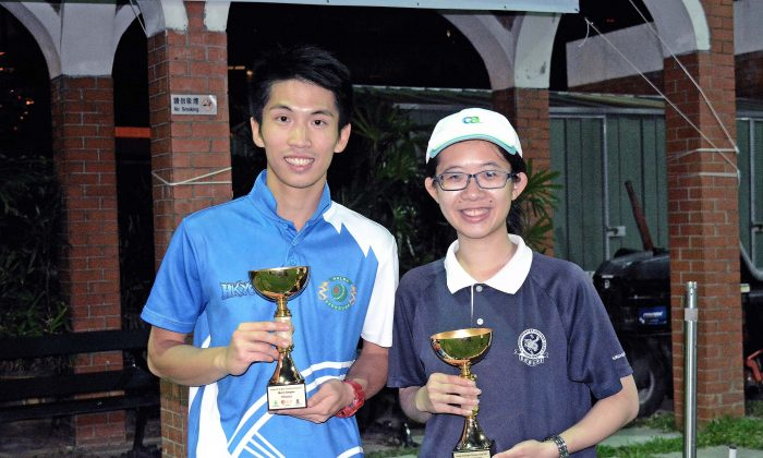 Jason Choi (left) and Angel So proudly show the most precious title they won in their youthhood – the U25 Singles Championship after winning their finals at Kowloon Cricket Club last Sunday, Dec 3. (Stephanie Worth)