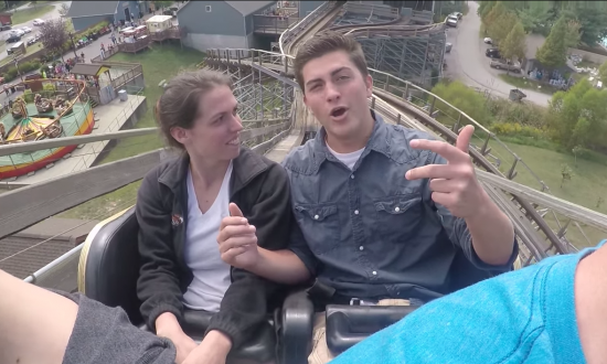 After 15 min delay over issue, they're finally on rollercoaster. But when it gets to the top—she's in tears