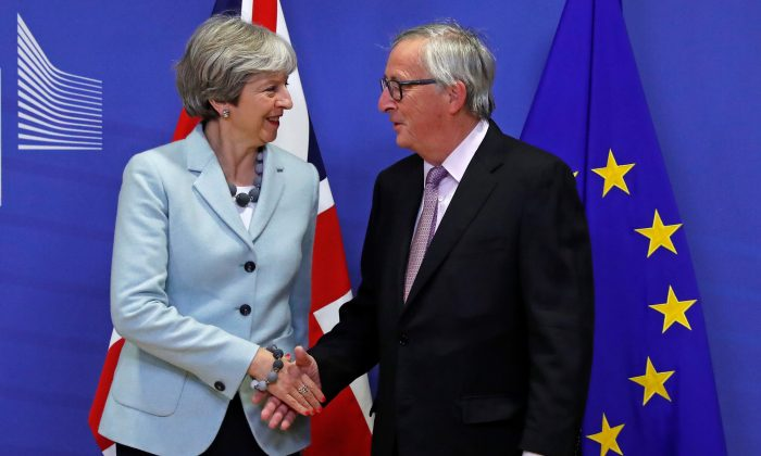 Britain's Prime Minister Theresa May is welcomed by European Commission President Jean-Claude Juncker at the EC headquarters in Brussels, Belgium Dec. 8, 2017.  (Reuters/Yves Herman)