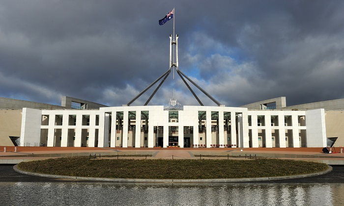 The Australian national flag flies over Parliament House in Canberra in this file image.(Torsten Blackwood/AFP/Getty Images)