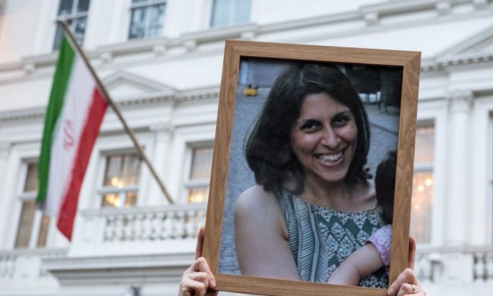 Supporters hold a photo of Nazanin Zaghari-Ratcliffe during a vigil for British-Iranian mother, Nazanin Zaghari-Ratcliffe, imprisoned in Tehran outisde the Iranian Embassy on January 16, 2017 in London, England. ( Chris J Ratcliffe/Getty Images)