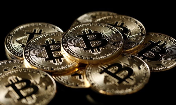 A collection of Bitcoin (virtual currency) tokens are displayed in this picture illustration taken Dec. 8, 2017. (Reuters/Benoit Tessier/Illustration)