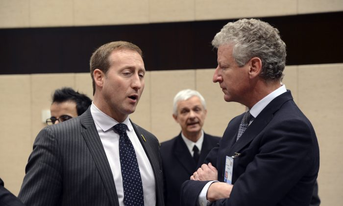 Then-Canadian defence minister Peter MacKay talks to his Belgian counterpart Pieter De Crem during a North Atlantic Council meeting of Ministers of Defence and ISAF partners at NATO headquarters in Brussels on Feb. 22, 2013. (Thierry Charlier/AFP/Getty Images)
