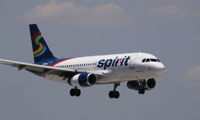 A  Spirit Airlines plane lands at the Fort Lauderdale-Hollywood International Airport on May 9, 2017, in Fort Lauderdale, Fla. Yesterday a chaotic scene erupted at the Spirit Airlines counter after flights were canceled which led to passengers getting irate and the police had to move in to restore order. (Joe Raedle/Getty Images)