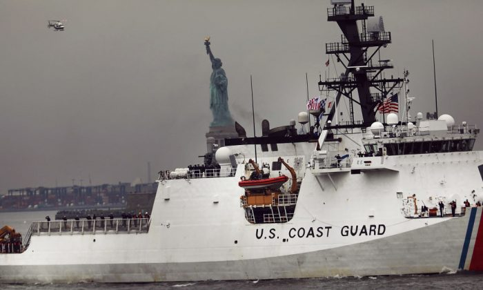 A Coast Guard ship makes its way past the Statue of Liberty on the opening day of Fleet Week on May 24, 2017 in New York City. (Spencer Platt/Getty Images)