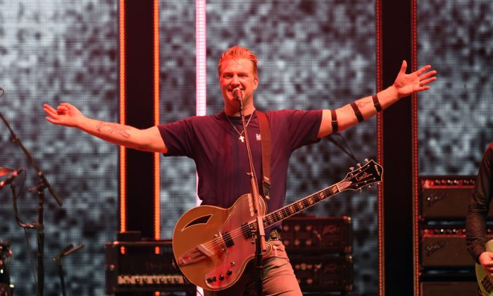 Josh Homme performs onstage during KROQ Almost Acoustic Christmas 2017 at The Forum on Dec. 9, 2017 in Inglewood, California. (Kevin Winter/Getty Images for KROQ)