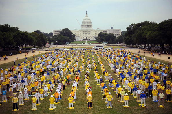 Hundreds of Falun Gong practitioners meditate to mark the 10th anniversary of start of the persecution in China at the National Mall in Washington, DC, on July 17, 2009. (Tim Sloan/AFP/Getty Images)