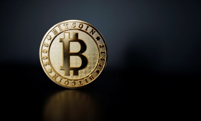 A Bitcoin (virtual currency) coin is seen in an illustration picture taken at La Maison du Bitcoin in Paris, France, June 23, 2017. (Reuters/Benoit Tessier/Illustration)