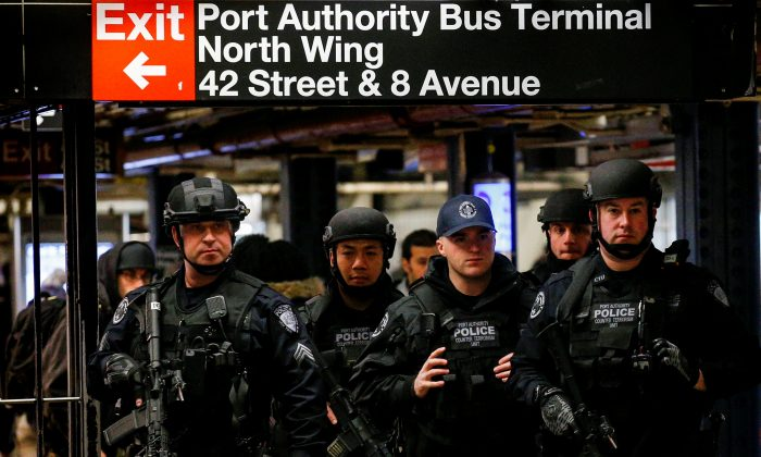 Members of the Port Authority Police Counter Terrorism unit patrol the subway corridor, at the New York Port Authority subway station near the site of an attempted detonation the day before, during the morning rush in New York City, U.S. December 12, 2017. REUTERS/Brendan McDermid